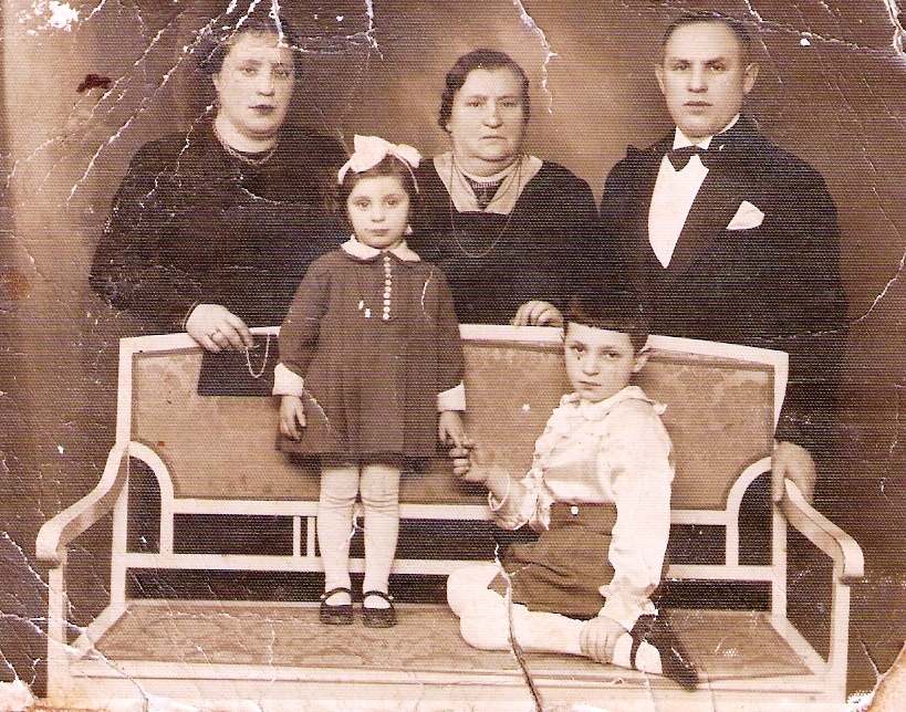 Smolyansky family. Standing from right: Haim Smolyansky, his mother-in-law Yocheved, his first wife Sonia. Sitting: Yankel and Mina Smolyansky. In December 1941, while Haim was at work, all the rest were murdered.